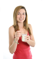 happy woman on 40s eating yogurt in health concept
