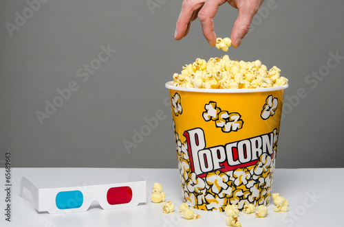 Hand reaching for popcorn