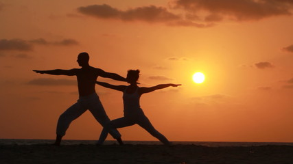 Silhouette of a beautiful Yoga couple