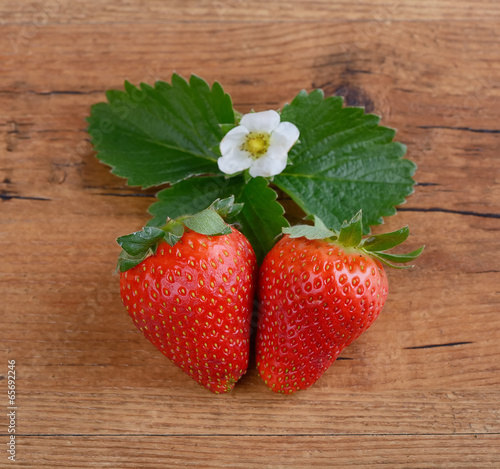Strawberries in red heart shape bowl