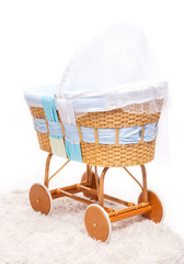 Cradle styled as retro pram over white