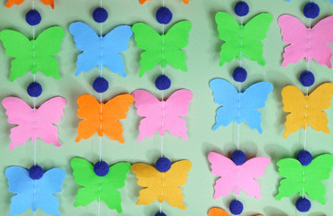 Handmade garland on color background