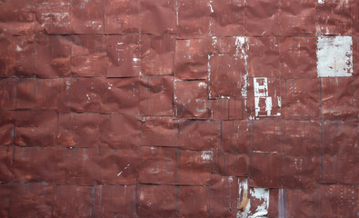 riveted red metal sheet wall