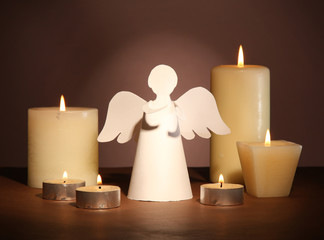 Christmas angel with candles on dark background