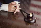 Judge Rests Hands Behind Gavel with American Flag Table Reflecti - 65694411