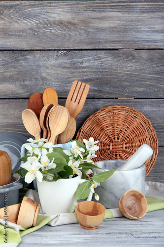 Composition of wooden cutlery, mortar, bowl and cutting board
