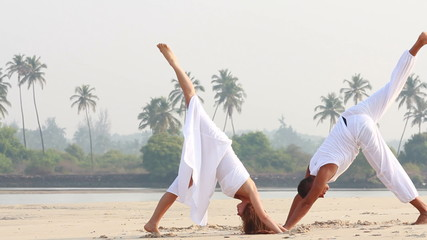 woman and man doing yoga