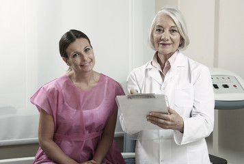 Expert female doctor showing medical exams to happy woman in 40s