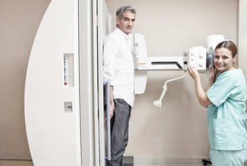 Female doctor with male patient at x-ray machine