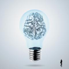 3d metal human brain in a lightbulb as creative concept