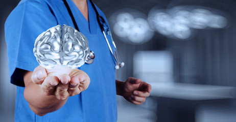 medical  doctor with brain3d meatl in his hands as concept