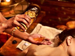 Woman having massage spa treatment.
