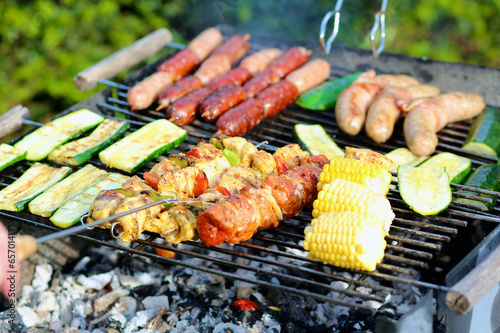 Assorted meat and vegetables on barbecue grill © cromary