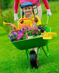 Gardening, planting - girl with mother in the garden