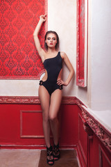 Sexy woman in swimsuit red vintage interior