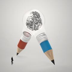 3d metal human brain inside pencil light bulb  as concept