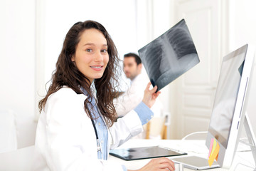 Woman doctor analysing X-ray