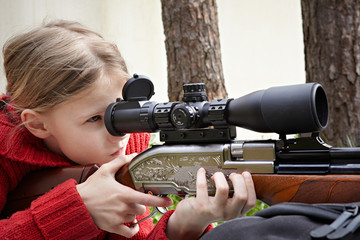 Girl aiming a airgun