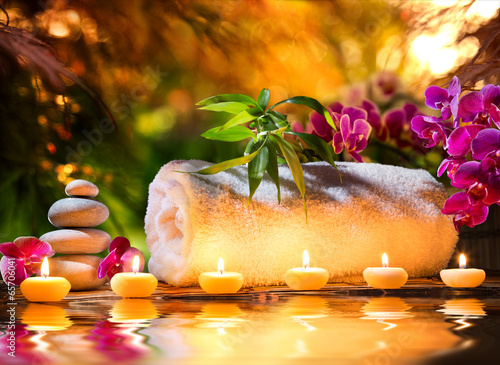 spa massage in garden - candles and water