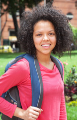 Female student with curly hair looking at camera