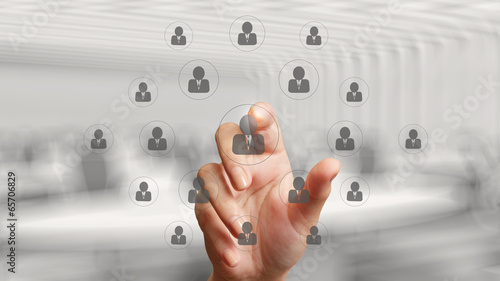 businessman hand points the human resources, CRM and social medi