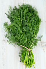 bunch of dill on wooden surface