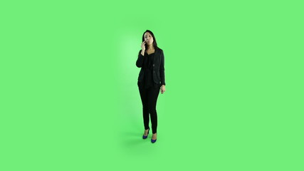 business woman isolated on green screen confidetn with phone