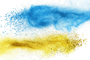 Blue and yellow powder explosion isolated