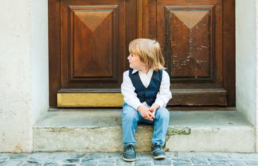 Outdoor portrait of a cute toodler boy