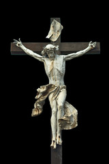 Crucifixion. Christian cross with Jesus Christ statue isolated o