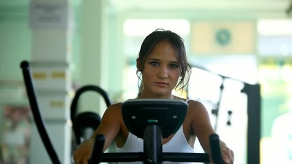 Beautiful woman at the gym on bike. 3 clips