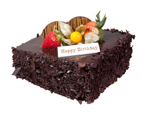 Chocolate birthday cake with strawberry topping isolated