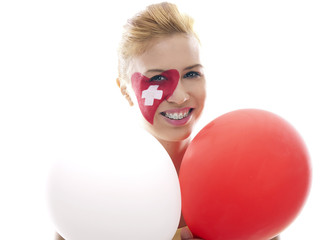 smiling girl with swiss flag painted on her face