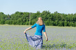 girl with blue skirt dance in cornflower meadow