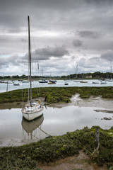 Landscape of moody evening sky over low tide marine