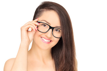 Stylish young girl with eyeglasses posing