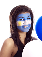 smiling girl with argentinian flag painted on her face