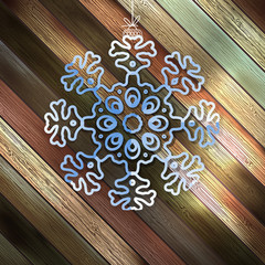 Paper christmas snowflake on a wood. EPS 10
