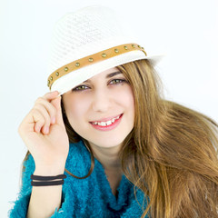 Happy cute female teenager smiling with hat