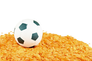 Soccer ball on orange confetti