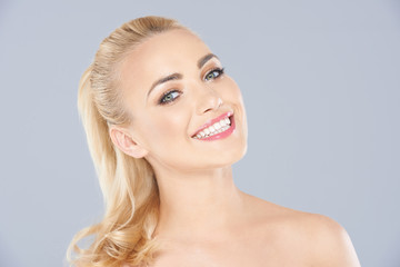 Attractive blond woman with a beaming smile