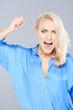 Temperamental woman raising her fist in anger