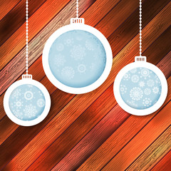 Blue paper christmas balls on a wood. EPS 10