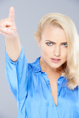 Angry beautiful blond woman