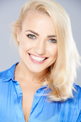 Beautiful happy blond woman with a joyful smile