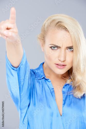 Angry beautiful blond woman