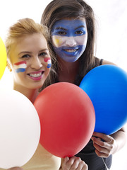 dutch and argentinian flags painted on girls' faces
