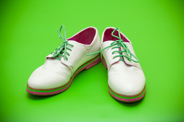 White shoes on a green background
