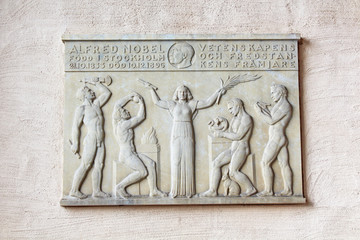 Nobel memorial plaque on the wall in Stockholm City Hall, Sweden