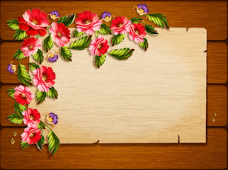 Frame of flowers on a wooden background